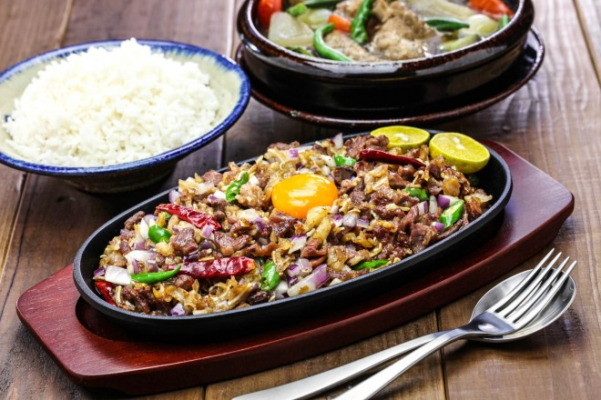 Food_sisig and sinigang, filipino cuisine_shutterstock_518419654