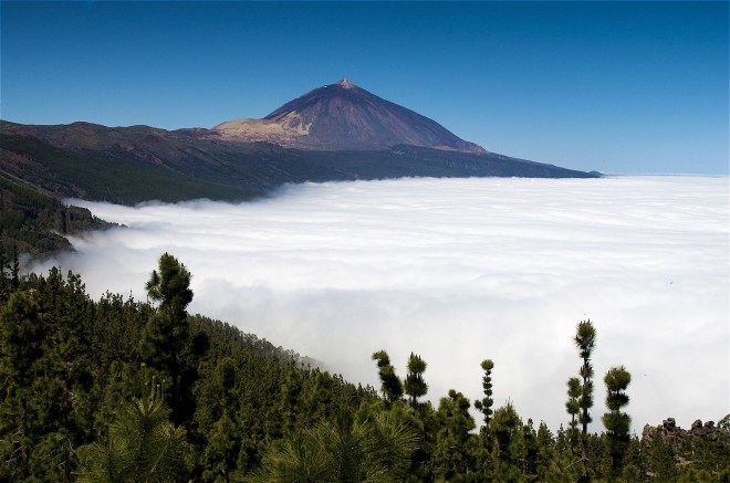 Spain, Canary Islands, Tenerife, Cloud cover clims the slopes of the Teide Volcan